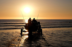 © Licensed to London News Pictures.12/06/15<br /> Saltburn by the Sea, England<br /> <br /> The crew of the fishing boat Senna head down to the shore line before launching as dawn breaks over Saltburn by the Sea.<br /> <br /> Photo credit : Ian Forsyth/LNP