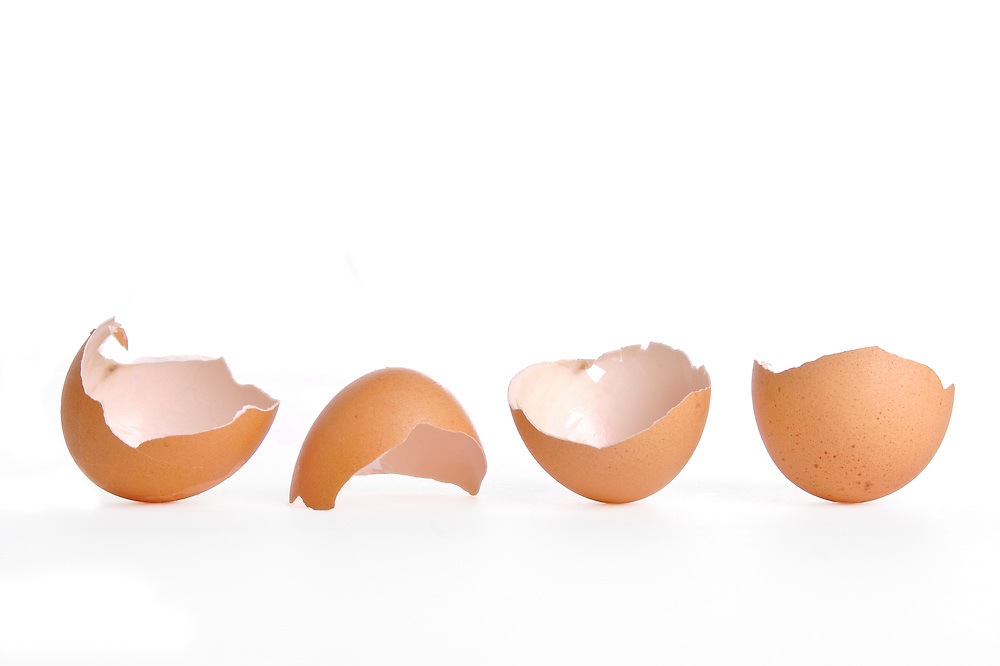Still life of  four eggs on a plate.