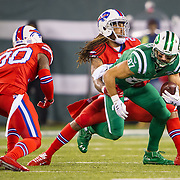 Nov 12, 2015; East Rutherford, NJ, USA;  New York Jets wide receiver Eric Decker (87) getting tackled by Buffalo Bills cornerback Stephon Gilmore (24) in the first half at MetLife Stadium. The Bills defeated the Jets 22-17 Mandatory Credit: William Hauser-USA TODAY Sports