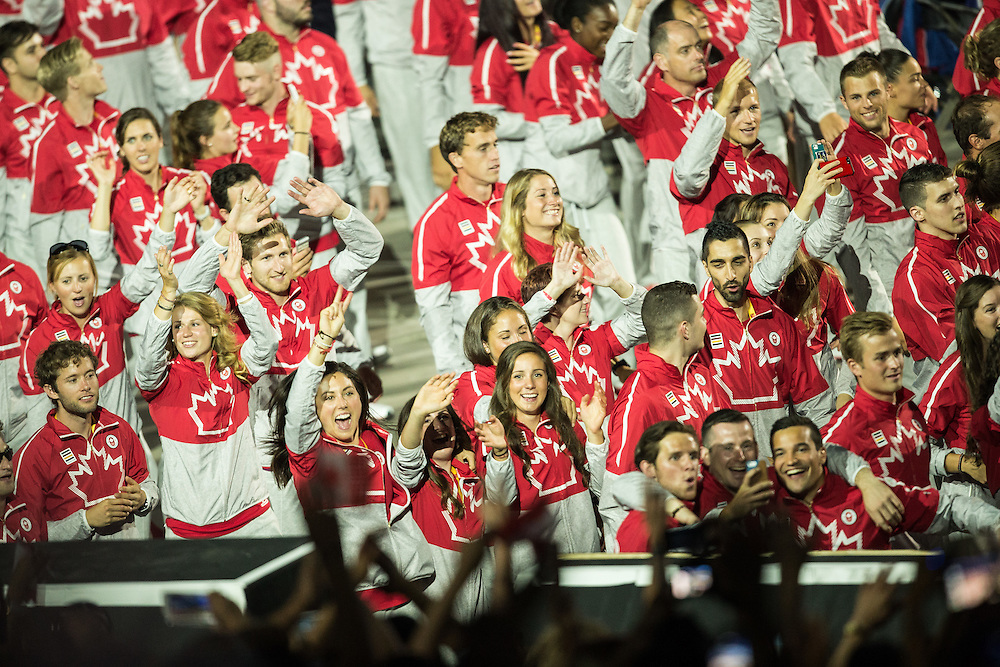 Members of team Canada wave to the crowd during the opening ceremonies at the 2015 Pan American Games in Toronto, Canada, July 10,  2015.  AFP PHOTO/GEOFF ROBINS