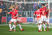 Salford City defender Cameron Burgess celebrate his goal with team-mates during the EFL Sky Bet League 2 match between Salford City and Scunthorpe United at the Peninsula Stadium, Salford, United Kingdom on 26 October 2019.
