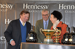 Left to right, NICKY HENDERSON, MAURICE HENNESSY and HRH The PRINCESS ROYAL at the 2013 Hennessy Gold Cup at Newbury Racecourse, Berkshire on 30th November 2013.