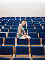 Businessman sitting alone on chair in Auditorium portrait