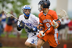 Virginia attackman Danny Glading (9) is defended by Duke midfielder Sam Payton (32).  The #2 ranked Duke Blue Devils defeated the #3 ranked Virginia Cavaliers 11-9 in the finals of the Men's 2008 Atlantic Coast Conference tournament at the University of Virginia's Klockner Stadium in Charlottesville, VA on April 27, 2008.