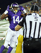 Minnesota Vikings wide receiver Stefon Diggs (14) complains to head linesman John McGrath (5) that he scored while returning a punt 62 yards to the one yard line setting up a touchdown during the 2015 NFL Pro Football Hall of Fame preseason football game against the Pittsburgh Steelers on Sunday, Aug. 9, 2015 in Canton, Ohio. The Vikings won the game 14-3. (©Paul Anthony Spinelli)
