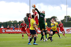 Hannah Cox of Oxford United punches the ball clear of Millie Farrow of Bristol City Women - Mandatory by-line: Robbie Stephenson/JMP - 25/06/2016 - FOOTBALL - Stoke Gifford Stadium - Bristol, England - Bristol City Women v Oxford United Women - FA Women's Super League 2