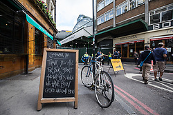 © Licensed to London News Pictures. 12/06/2017. London, UK. A defiant message on a sign outside the Southwark Tavern at the entrance to Borough Market as traders begin clearing up and prepare to reopen. The market was the scene of a terrorist attack on Saturday 3 June 2017 in which eight people were killed. Photo credit: Rob Pinney/LNP