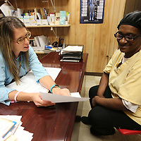 Tara Kilgore, Population Health Manager for Franklin Furniture in Houston, talks with Catherine Townsend, a Franklin Furniture employee, about her health chart Thursday at the Franklin plant in Houston. Franklin has teamed up with the North Mississippi Medical Center in adding an onsite population health nurse to help employees to manage chronic conditions as well as checking up on those who are recovering from surgery or hospital stays.