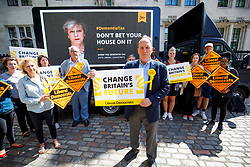 "© Licensed to London News Pictures. 03/06/2017. London, UK. SIMON HUGHES, Liberal Democrat candidate and former Southwark & Old Bermondsey MP reveals a new poster of Theresa May accompanied by the words: ""Don't bet your house on it"" to criticise the so called ""dementia tax"" in central London on Saturday 3 June 2017. Photo credit: Tolga Akmen/LNP"