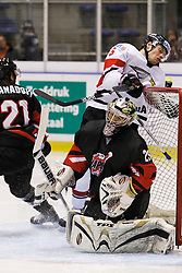22.04.2010, Eishalle, IJssportcentrum, Tilburg, NED, IIHF Division I WM, Gruppe A, Österreich vs Japan im Bild Thomas Raffl crashes into the goal, EXPA Pictures © 2010, PhotoCredit: EXPA/ Fintan Planting