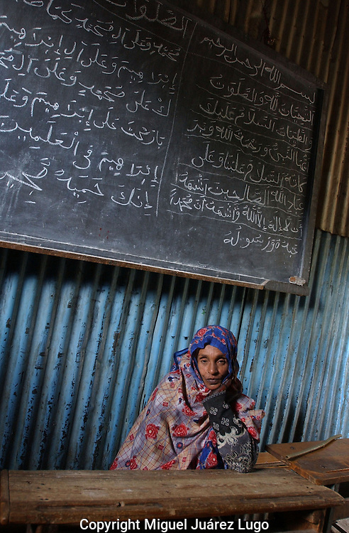 Dessie, Ethiopia: A first grade teacher at the Showber Islamic School, a madrassa in northern Ethiopia. The school, a sprawl of prefabricated steel, was built in the 1930s and is barely hanging on financially. (PHOTO: MIGUEL JUAREZ LUGO).