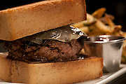 Food specialties created by the talented and creative Chef Jason Dodge at Peche Restaurant and Bar. Grilled Lamb Burger with Balsamic Onions, Caraway Texas toast and Lamb Chopper.