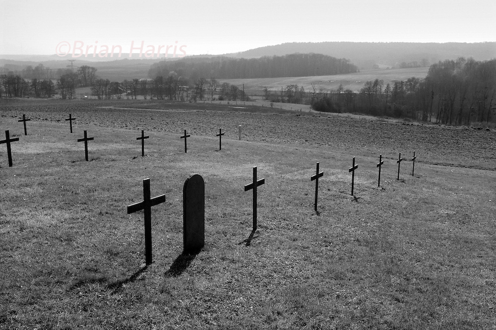Marfaux German Cemetery, Marfaux to the west of Reims, France. March 2014<br /> Seen here :<br /> Next to the Commonwealth War Graves Cemetery is a German WW1 Cemetery with 4417 war dead including 2700 in a mass grave most unnamed from the same period.<br /> <br /> The cemetery contains 1129 (341 unnamed )British and New Zealand WW1 war dead from the Second Battle of the Marne in the summer of 1918 when the German offensive towards Paris was halted and turned back, thus started the 100 days counter attack offensive leading to the Armistice and the end of the Great war on November 11th 1918. There is a shelter memorial to the missing from the New Zealand forces.<br /> Next to the Commonwealth War Graves Cemetery is a German WW1 Cemetery with 4417 war dead including 2700 in a mass grave most unnamed )from the same period.<br /> <br /> The Second Battle of the Marne (French: Seconde Bataille de la Marne), or Battle of Reims (15 July &ndash; 6 August 1918) was the last major German Spring Offensive on the Western Front during the First World War. The German attack failed when an Allied counterattack led by French forces and including several hundred tanks overwhelmed the Germans on their right flank, inflicting severe casualties. The German defeat marked the start of the relentless Allied advance which culminated in the Armistice about 100 days later. Thus the Second Battle of the Marne can be considered as the beginning of the end of the Great War.<br /> Marfaux British Cemetery is about one kilometre south-east of the village along the RD386, on the north-east side of the road to Nanteuil-la-Foret and on the south-east side of the crossroad from Bois-de-Courton.<br /> <br /> The Marfaux (New Zealand) Memorial takes the forms of a panel stone erected in the shelter in Marfaux British Cemetery, and commemorates, by name, 10 casualties of the New Zealand Cyclist Battalion who fell in July 1918 and who have no known grave.<br /> Historical Information<br /> <br /> Marfaux