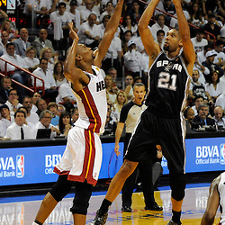 Jun 18, 2013; Miami, FL, USA; San Antonio Spurs power forward Tim Duncan (21) shoots against Miami Heat center Chris Bosh (1) during the first quarter of game six in the 2013 NBA Finals at American Airlines Arena.  Mandatory Credit: Derick E. Hingle-USA TODAY Sports