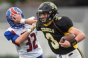 Mitchell's Kiel Nelson (3) stiff arms Douglas' Sheldon Wagner (32) while running the ball during a game on Friday at Joe Quintal Field in Mitchell. (Matt Gade / Republic)