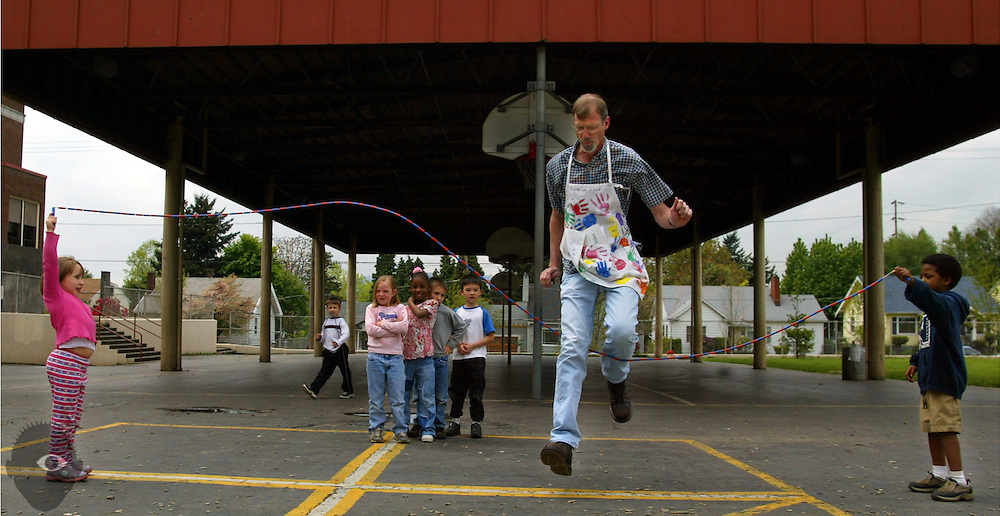 Kindergarten teacher Bob Parker (center) takes in some jump roping during recess at Grout Elementary School in Portland, Oregon. He is the tallest teacher in the school working with the smallest kids but they all adore him just the same.