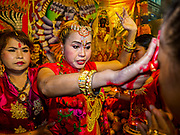 30 SEPTEMBER 2017 - BANGKOK, THAILAND: A woman leads a blessing ceremony during the Navratri parade in Bangkok. Navratri is a nine night (10 day) long Hindu celebration that marks the end of the monsoon and honors of the divine feminine Devi (Durga). The festival is celebrated differently in different parts of India, but the common theme is the battle and victory of Good over Evil based on a regionally famous epic or legend such as the Ramayana or the Devi Mahatmya. Navratri is celebrated throughout Southeast Asia in communities that have large Hindu population. Bangkok's celebration of Navratri was subdued this year because Thais are still mourning the death of Bhumibol Adulyadej, the Late King of Thailand, who died on October 13, 2016.      PHOTO BY JACK KURTZ
