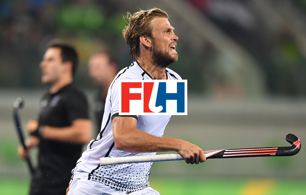 Germany's Moritz Furste celebrates his team's second goal during the men's quarterfinal field hockey Germany vs New Zealand match of the Rio 2016 Olympics Games at the Olympic Hockey Centre in Rio de Janeiro on August 14, 2016. / AFP / MANAN VATSYAYANA        (Photo credit should read MANAN VATSYAYANA/AFP/Getty Images)