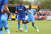AFC Wimbledon midfielder Liam Trotter (14) battles for possession with Coventry City Amadou  Bakayoko (21) during the EFL Sky Bet League 1 match between AFC Wimbledon and Coventry City at the Cherry Red Records Stadium, Kingston, England on 11 August 2018.