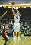 December 04 2010: Iowa Hawkeyes guard Eric May (25) puts up a shot during the second half of their NCAA basketball game at Carver-Hawkeye Arena in Iowa City, Iowa on December 4, 2010. Iowa won 70-53.