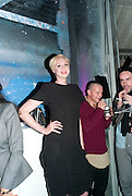 GWENDOLINE CHRISTIE; NATHANIEL LEE-JONES; RICHARD SLOAN, Giles Deacon after-show party. Elm lester painting rooms. Leicester Sq. London. 19 September 2011. <br /> <br />  , -DO NOT ARCHIVE-© Copyright Photograph by Dafydd Jones. 248 Clapham Rd. London SW9 0PZ. Tel 0207 820 0771. www.dafjones.com.