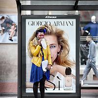 Nederland, Amsterdam , 19 september 2013.<br /> Advertenties van geurtjes in het straatbeeld.<br /> <br /> Op de foto: <br /> De nieuwe campagne van Armani, Si, met Cate Blanchett, hier gefotografeerd op de Damrak.<br /> Foto:Jean-Pierre Jans