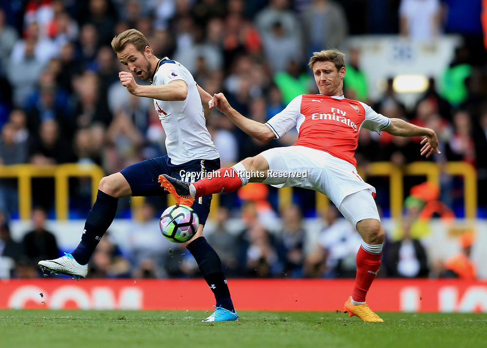 April 30th 2017, White Hart Lane, Tottenham, London England; EPL Premier League football Tottenham Hotspur versus Arsenal; Harry Kane of Tottenham Hotspur and Nacho Monreal of Arsenal compete for the ball