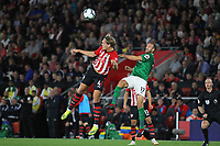Football - 2018 / 2019 Premier League - Southampton vs. Brighton and Hove Albion<br /> <br /> Southampton's Jannik Vestergaard out jumps Glenn Murray of Brighton to win another header in the aerial dual at St Mary's Stadium Southampton<br /> <br /> COLORSPORT/SHAUN BOGGUST