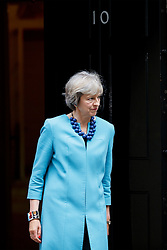 © Licensed to London News Pictures. 13/09/2016. London, UK. Prime Minister THERESA MAY leaves Number 10 to greet State Counsellor of Myanmar Aung San Suu Kyi in Downing Street, London on 13 September 2016. Photo credit: Tolga Akmen/LNP