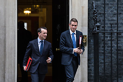 © Licensed to London News Pictures. 14/11/2017. London, UK. Secretary of State for Wales Alun Cairns (L) and Defence Secretary Gavin Williamson (R) leave 10 Downing Street after the weekly Cabinet meeting. Photo credit: Rob Pinney/LNP