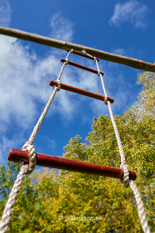 Low angle view of rope ladder suspended from pole. Close-up, climbing frame.