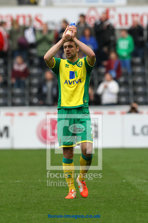 A dejected looking Russell Martin of Norwich applauds the traveling support at the end of the Barclays Premier League match at the Liberty Stadium, Swansea<br /> Picture by Paul Chesterton/Focus Images Ltd +44 7904 640267<br /> 29/03/2014