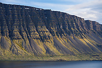 Mountainside in Dynjandisvogur in evening light, West fiords of Iceland.