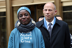 December 17, 2018 - New York, New York, US - Protester THERESE PATRICIA OKOUMOU, 44, who was charged with trespassing, disorderly conduct and interfering with government functions after partially climbing the Statue of Liberty monument on July 4, 2018, was found guilty on all charges in the U.S. Federal Court in lower Manhattan. The Congolese-born US naturalized-citizen, will be sentenced on March 5, 2019 and  faces up to 6 months of jail on each of three different charges. Pictured is THERESE PATRICIA OKOUMOU and legal advisor Attorney MICHAEL AVENATTI. (Credit Image: © G. Ronald Lopez/ZUMA Wire)