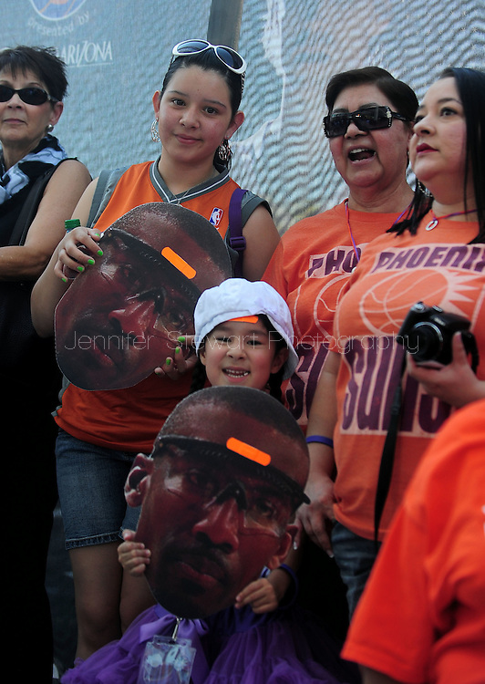 May 29, 2010; Phoenix, AZ, USA; Fans hold Phoenix Suns forward Amare Stoudemire (1) masks with a bandaid on the forehead prior to game six of the western conference finals in the 2010 NBA Playoffs at US Airways Center.  Mandatory Credit: Jennifer Stewart-US PRESSWIRE