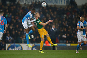 Tosin Adarabioyo of Blackburn Rovers  and Jayden Stockley of Preston North End contest an aerial ball  during the EFL Sky Bet Championship match between Blackburn Rovers and Preston North End at Ewood Park, Blackburn, England on 11 January 2020.
