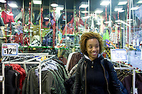 28 November, 2008. Brooklyn, New York. Caroline Filistin, 25, a student from Montreal shops here at a Dr Jay's store at the Fulton Street Mall on Black Friday, the day that is supposed to be the busiest of the year.<br /> <br /> ©2008 Gianni Cipriano for The New York Times<br /> cell. +1 646 465 2168 (USA)<br /> cell. +1 328 567 7923 (Italy)<br /> gianni@giannicipriano.com<br /> www.giannicipriano.com