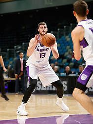 November 19, 2017 - Reno, Nevada, U.S - Reno Bighorns Center GEORGIOS PAPAGIANNIS (13) receives a pass from Reno Bighorns Guard DAVID STOCKTON (11) during the NBA G-League Basketball game between the Reno Bighorns and the Long Island Nets at the Reno Events Center in Reno, Nevada. (Credit Image: © Jeff Mulvihill via ZUMA Wire)