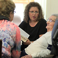 Sissie Craft sits with her parents Maldon and Carolyn Griffin as they read through the Bible with Maldon at the Green House residents at Traceway Retirement Community.