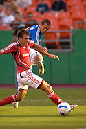 July 1, 2007 - Kansas City, MO..Kansas City Wizards forward Davy Arnaud #22 fires a shot on goal against pressure from Toronto FC midfielder Chris Pozniak #13 in the first half at Arrowhead Stadium in Kansas City, Missouri on July 1, 2007...MLS:  The Toronto FC and Wizards ended in a 1-1 tie.   .Photo by Peter G. Aiken / Cal Sport Media