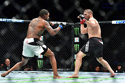 "Nov 12, 2016 - New York, New York, U.S. - Khabib Nurmagomedov ""The Eagle"" (red gloves) vs. Michael ""The Menace"" Johnson (blue gloves) during UFC 205 at Madison Square Garden. (Credit Image: © Jason Silva via ZUMA Wire)"