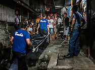 Ginnalyn Soriano, 21 encounters the body of her elder brother, Julius, 24 years old, whose corpse is being carried away in a body bag after he was executed.  His body showed signs that his hands had been bound before he was shot to death during a police operation in Caloocan, Metro Manila. Philippines