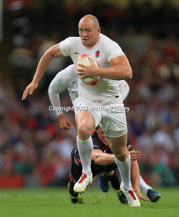 Mike Tindall of England runs with the ball. Wales v England, Millennium Stadium, Cardiff, Rugby Union, 12/08/2011 © Matthew Impey/Wiredphotos.co.uk. tel: 07789 130 347 email: matt@wiredphotos.co.uk