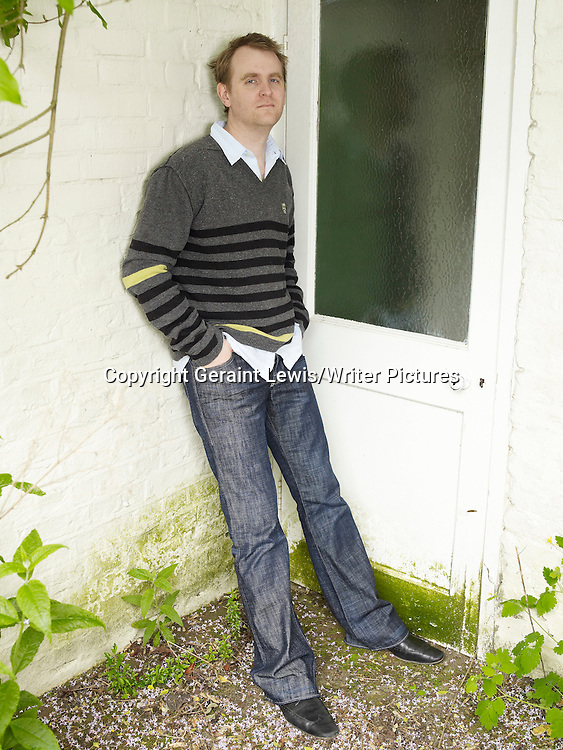 Nick Harkaway  , novelist and Screenwriter photographed at his London home<br />