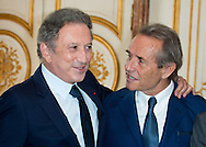 """Michel Drucker, Jacky Ickx attends at the ceremony who Michel Drucker was awarded at  the title of Commander of the Order of the Crowne at the Palace Egmont"""" at Brussels, 2014 in Brussels, Belgium."""