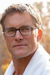 portrait of a handsome middle aged man wearing glasses