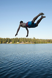 United States, Washington, Lake Sawyer, teenage boy diving into lake