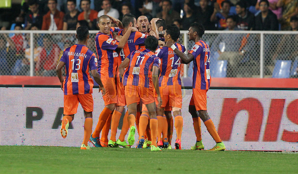 FC Pune City players celebrates after Kostas Katsouranis of FC Pune City scores a goal during match 14 of the Hero Indian Super League between FC Pune City and FC Goa held at the Shree Shiv Chhatrapati Sports Complex Stadium, Pune, India on the 26th October 2014.<br /> <br /> Photo by:  Vipin Pawar/ ISL/ SPORTZPICS