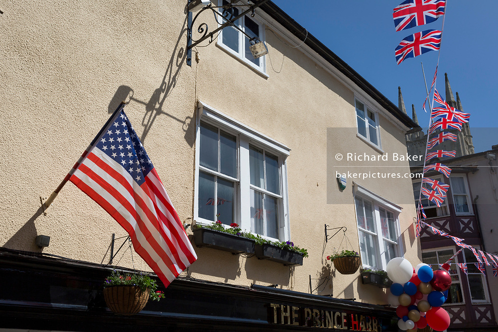 US and British flags and balloons outside the Prince Harry pub in the old town of Windsor as it gets ready for the royal wedding between Prince Harry and his American fiance Meghan Markle, on 14th May 2018, in London, England. (Photo by Richard Baker / In Pictures via Getty Images)