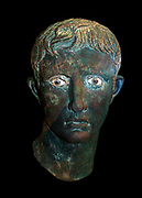 Bronze head from an over life-sized statue of Augustus (the Meroe Head) Roman, probably made in Egypt, About 27-25 BC, found at Meroe Sudan. Statues of the emperor, together with images of him on coins and painted parts were essential for imperial propaganda.